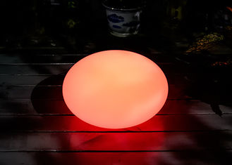 China Oval Shaped Solar LED Ball PE Shell And ABS Base Material Size 35*35*27cm supplier